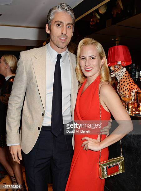 Charlotte Olympia Dellal and George Lamb attend the Charlotte Olympia 'Handbags for the Leading Lady' launch dinner at Toto's Restaurant on October...