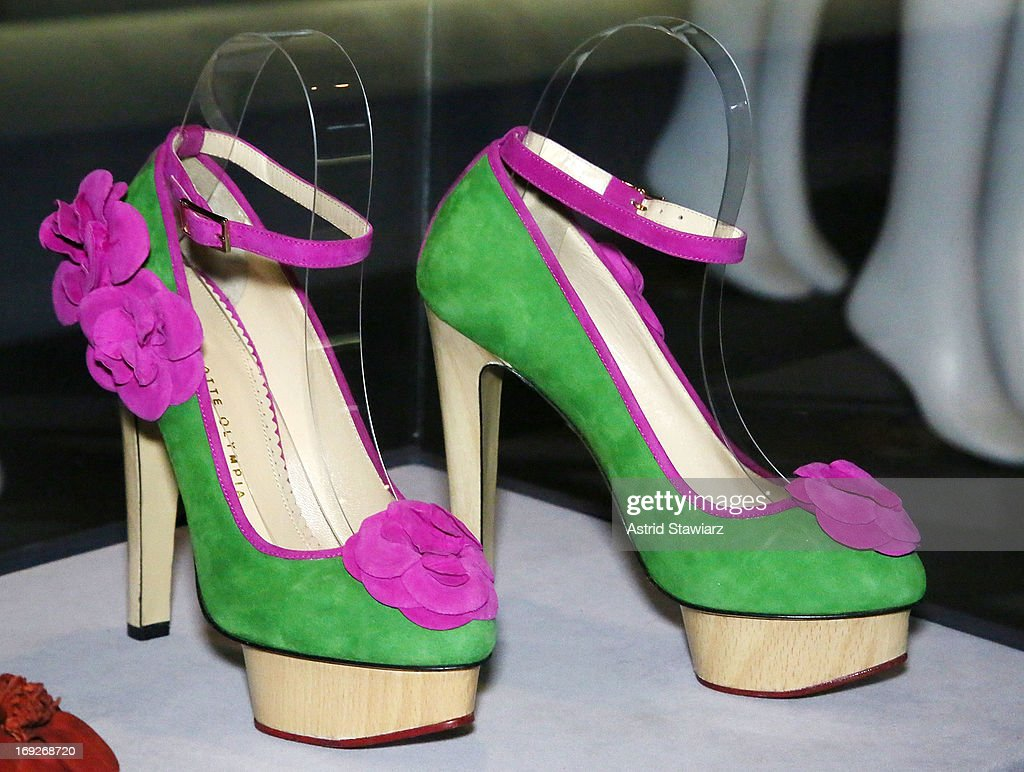 Charlotte Olympia platform pumps, green and pink suede, pre-fall 2012 are displayed at the RetroSpective Press Preview at The Museum at FIT on May 22, 2013 in New York City.
