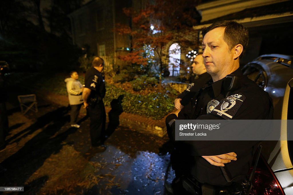 Charlotte police officers assist FBI agents during a search of the home of Paula Broadwell on November 13, 2012 in the Dilworth neighborhood of Charlotte, North Carolina. Broadwell is the recently discovered mistress of CIA Director David Petraeus, which has led to his resignation in light of the scandal.