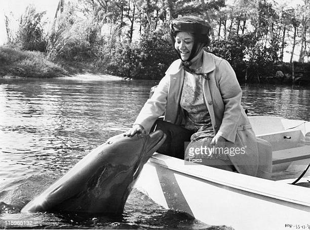 Charlotte Rae shares an affectionate moment with a dolphin in the science fiction comedy 'Hello Down There' directed by Jack Arnold and Ricou...