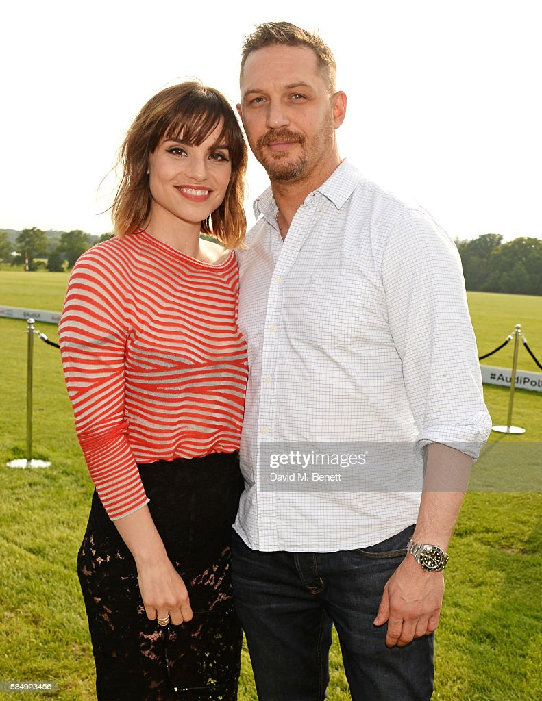 Charlotte Riley (L) and Tom Hardy attend day one of the Audi Polo Challenge at Coworth Park on May 28, 2016 in London, England.
