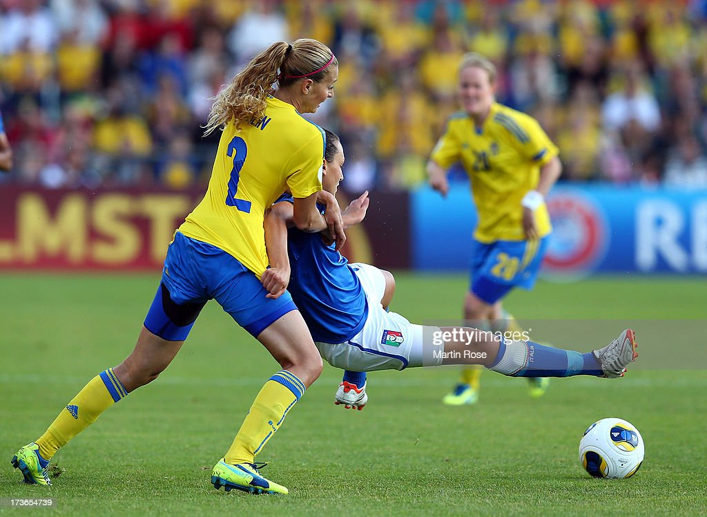Charlotte Rohlin (L) of Sweden and Ilaria Mauro (R) of Italy battle for the ball during the UEFA Women's Euro 2013 group A match between Sweden and Italy at Orjans Vall on July 16, 2013 in Halmstad, Sweden.