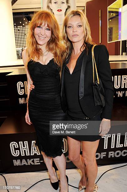 Charlotte Tilbury and Kate Moss pose at a photocall to unveil a new portrait by artist Chris Levine during the launch of 'Charlotte Tilbury's MakeUp...