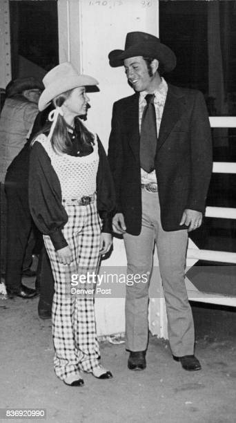 Charlotte Turner of Durant Okla likes a modern knit tank sweater with her plaid jeans which seems to suit Lewis Feuerstein of Butterwillow Calif Both...