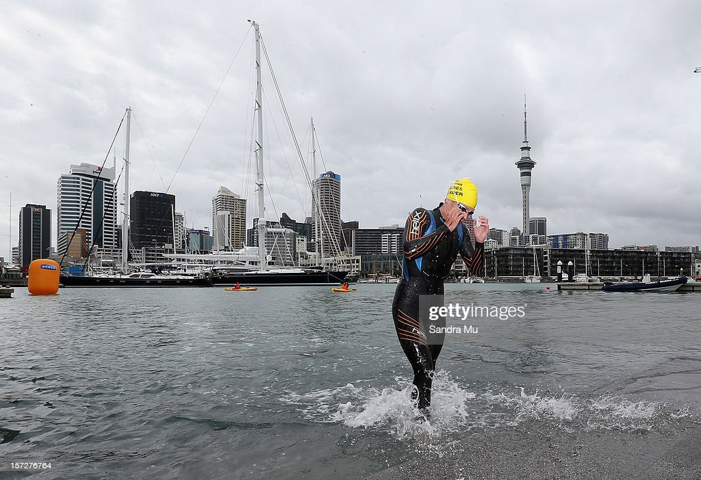 Charlotte Webby emerges from the water in second place during the Auckland Harbour Crossing ocean swim event at the Viaduct Harbour on December 2, 2012 in Auckland, New Zealand.