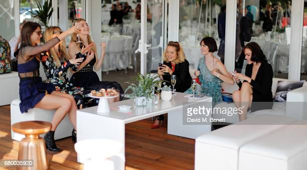 Charlotte Wiggins guest Eve Delf Tess Ward Sam Rollinson and Eliza Cummings attend the Audi Polo Challenge at Coworth Park on May 7 2017 in London...