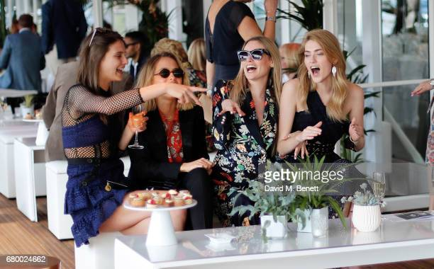 Charlotte Wiggins Tess Ward guest Eve Delf attend the Audi Polo Challenge at Coworth Park on May 7 2017 in London United Kingdom