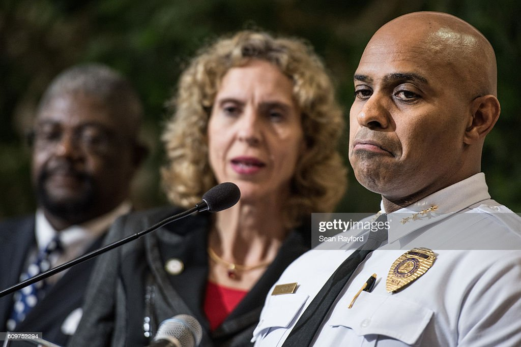 Charlotte-Mecklenburg Police Chief Kerr Putney, right, and Charlotte Mayor Jennifer Roberts field questions from the media September 22, 2016 in Charlotte, North Carolina. Protests began on Tuesday night following the fatal shooting of 43-year-old Keith Lamont Scott at an apartment complex near UNC Charlotte.