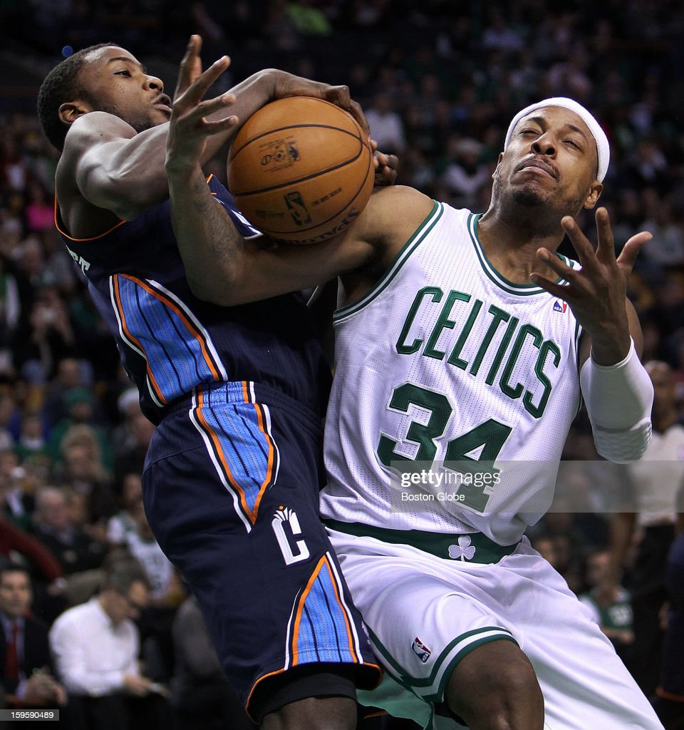 Charlotte's Michael Kidd-Gilchrist, left, and the Celtics' Paul Pierce, right, battle for a first quarter rebound as the Boston Celtics hosted the Charlotte Bobcats in a regular season NBA game at TD Garden.