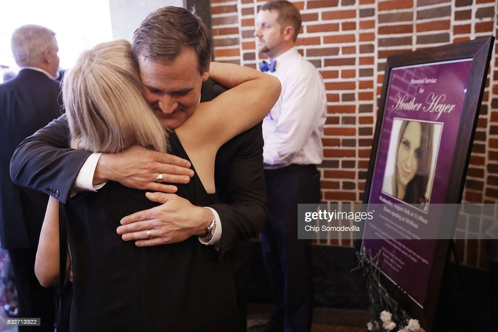 Charlottesville Mayor Mike Singer (C) embraces a supporter outside the Paramount Theater following a memorial service for Heather Heyer August 16, 2017 in Charlottesville, Virginia. The memorial service was held four days after Heyer was killed when a participant in a white nationalist, neo-Nazi rally allegedly drove his car into the crowd of people demonstrating against the 'alt-right' gathering.