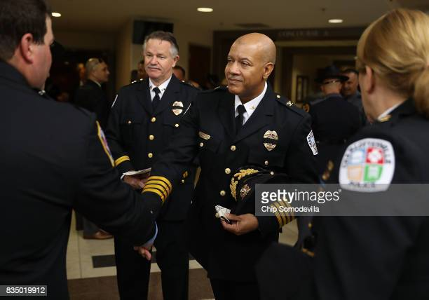 Charlottesville Police Chief Al Thomas Jr greets fellow law enforcement officers as they arrive at Saint Paul's Baptist Church ahead of the funeral...