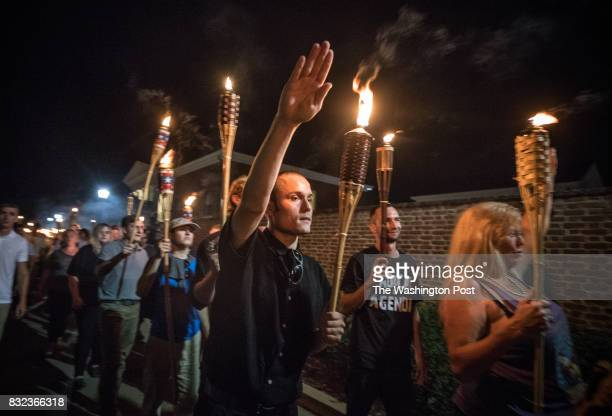 Chanting White lives matter You will not replace us and Jews will not replace us several hundred white nationalists and white supremacists carrying...