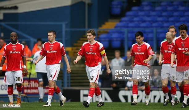 Charlton Athletic captain Matthew Holland leads Leroy Lita Darren Ambrose Zheng Zhi Ben Thatcher and Patrick McCarthy out at Portmand Road
