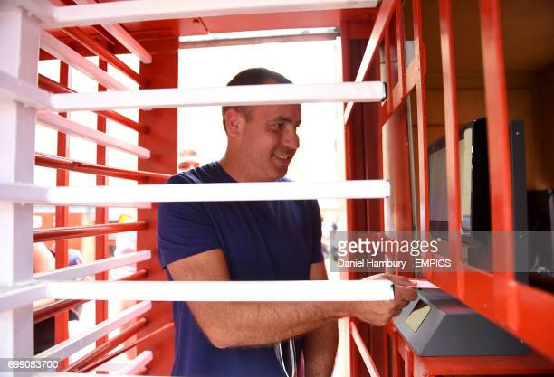 Charlton Athletic fans scan their tickets at the turnstiles at The Valley before the game