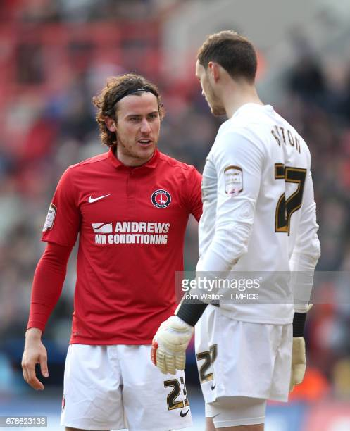 Charlton Athletic goalkeeper David Button in conversation with teammate Lawrie Wilson during a break in play