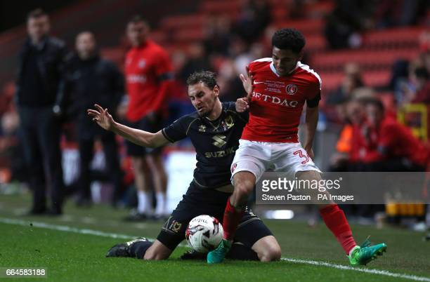 Charlton Athletic Jay Dasilva and MK Dons Ed Upson during the Sky Bet League One match at The Valley London