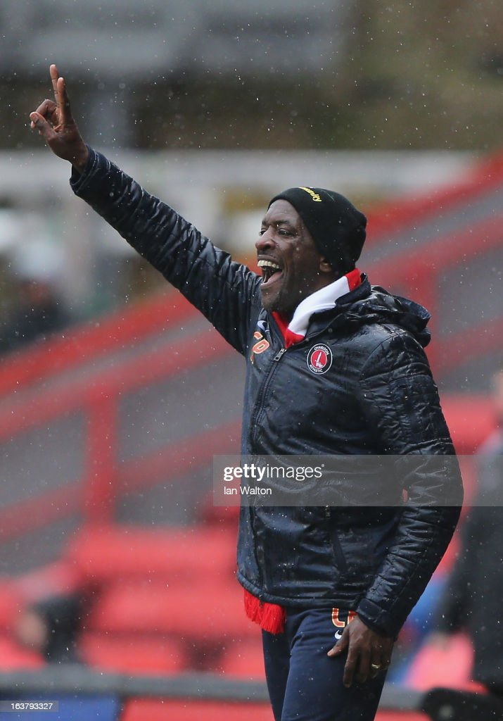 Charlton Athletic manager <a gi-track='captionPersonalityLinkClicked' href=/galleries/search?phrase=Chris+Powell+-+Fu%C3%9Fballspieler+und+Trainer&family=editorial&specificpeople=13623254 ng-click='$event.stopPropagation()'>Chris Powell</a> gestures during the npower Championship match between Charlton Athletic and Millwall at The Valley on March 16, 2013 in London, England.