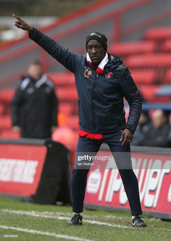 Charlton Athletic manager <a gi-track='captionPersonalityLinkClicked' href=/galleries/search?phrase=Chris+Powell+-+Joueur+de+football+et+entra%C3%AEneur&family=editorial&specificpeople=13623254 ng-click='$event.stopPropagation()'>Chris Powell</a> gestures during the npower Championship match between Charlton Athletic and Millwall at The Valley on March 16, 2013 in London, England.