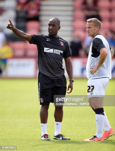 Charlton Athletic manager Chris Powell speaks with Mark Gower