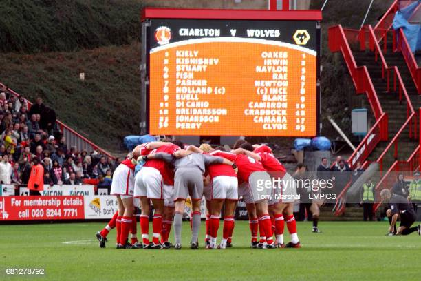 Charlton Athletic players form a huddle in front of the new Jumbotron screen at the Valley