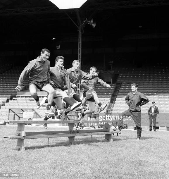 Charlton Athletic players training for the forthcoming season left to right Peter Burridge Keith Peacock Michael Rose and Charlie Wright Watching at...
