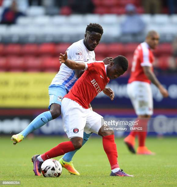 Charlton Athletic's Ademola Lookman and Coventry City's Gael Bigirimana battle for the ball
