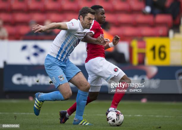 Charlton Athletic's Ademola Lookman and Coventry City's Sam Ricketts battle for the ball