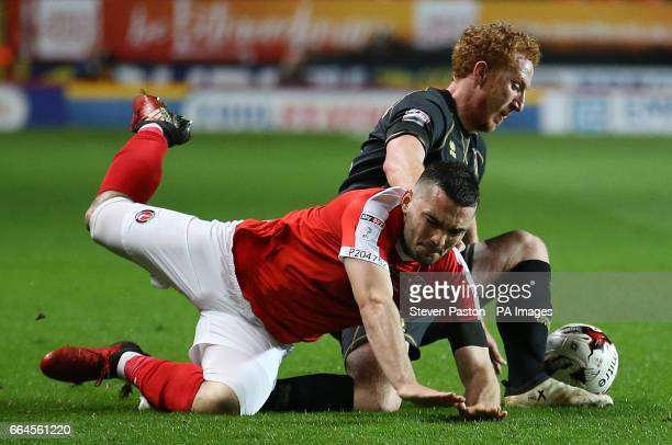 Charlton Athletic's Ademola Lookman and MK Dons Dean Lewington battle for the ball during the Sky Bet League One match at The Valley London