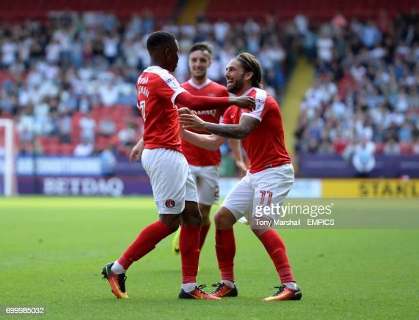 Charlton Athletic's Ademola Lookman celebrates scoring a goal with Ricky Holmes