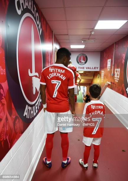 Charlton Athletic's Ademola Lookman stands waiting with a mascot in the tunnel before the game