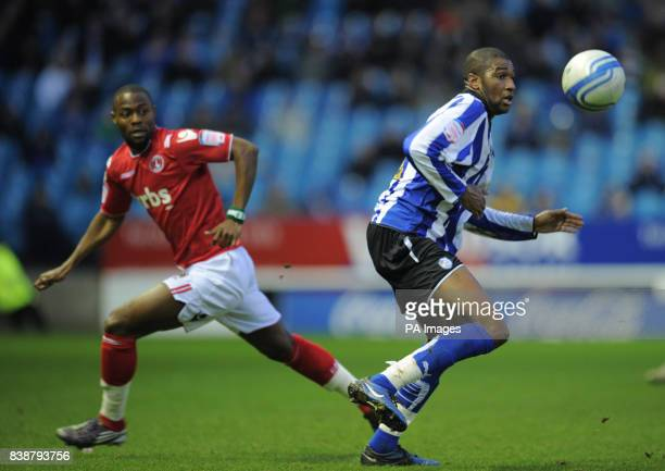 Charlton Athletic's Akpo Sodje challenges Sheffield Wednesday's Reda Johnson during the npower League One match at Hillsborough Sheffield
