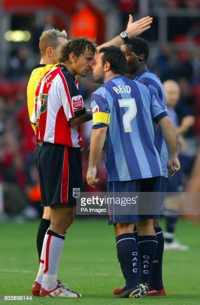Charlton Athletic's Andy Reid and Southampton's Inigo Idiakez square up as Charlton's Jose Semedo is sent off during the CocaCola Football...