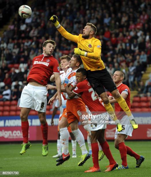 Charlton Athletic's Ben Hamer and Dale Stephens clear danger from Blackpool's Kirk Broadfoot during the Sky Bet Championship match at The Valley...