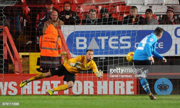Charlton Athletic's Ben Hamer can't stop Leeds United's Ross McCormack scoring his side's second goal from the penalty spot