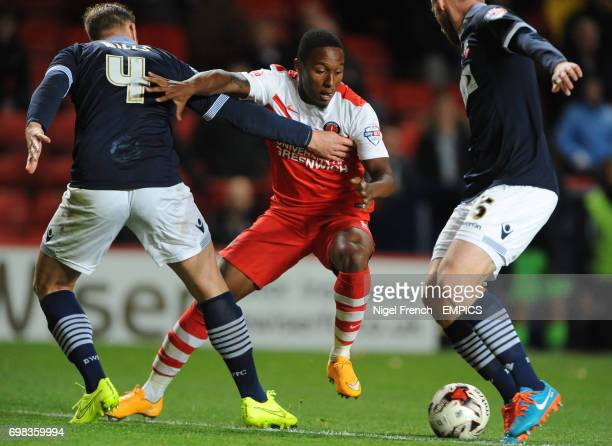 Charlton Athletic's Callum Harriott battle for the ball against Bolton Wanderers' Matthew Mills and Tim Ream
