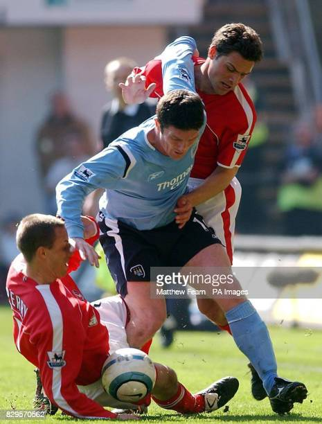 Charlton Athletic's Chris Perry and Luke Young tackle Manchester City's Jon Macken