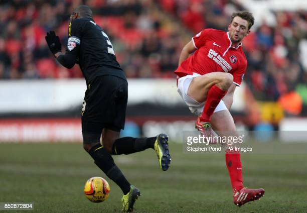 Charlton Athletic's Dale Stephens and Sheffield Wednesday's Reda Johnson compete for the ball during the Sky Bet Championship match at The Valley...