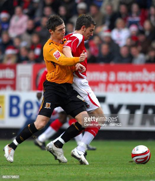 Charlton Athletic's Darren Ambrose and Hull City's Bryan Hughes battle for the ball