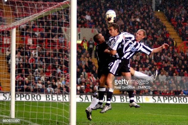 Charlton Athletic's Dean Kiely saves under pressure from Newcastle United's Darren Ambrose and Nicky Butt