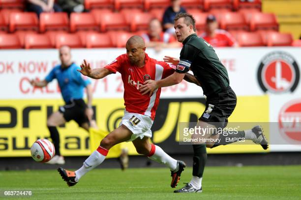 Charlton Athletic's Deon Burton and Walsall's Mark Hughes battle for the ball