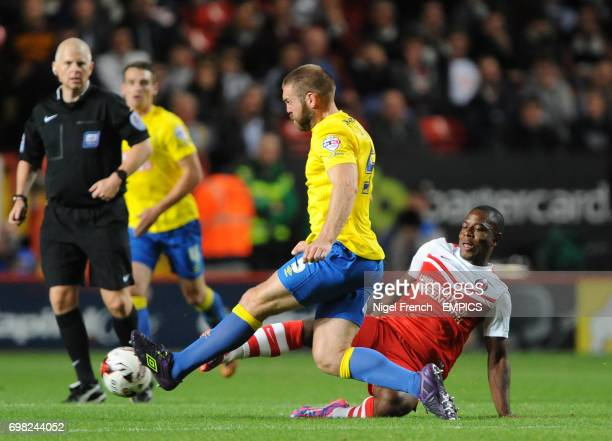Charlton Athletic's Franck Moussa challenges Derby County's Derby County's Jake Buxton for the ball