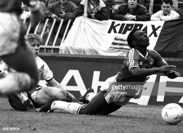 Charlton Athletic's Garth Crooks goes down after tangling with Leeds United's Ian Baird during the First Division playoff at Selhurst Park