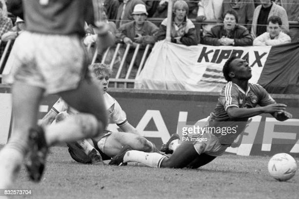 Charlton Athletic's Garth Crooks is brought down by Leeds United's Ian Baird