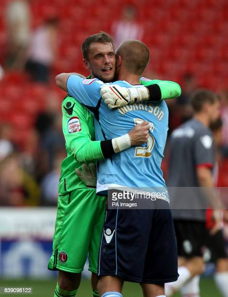 Charlton Athletic's goalkeeper Ben Hamer celebrates their victory at the end of the match with Michael Morrison during the npower Football League one...