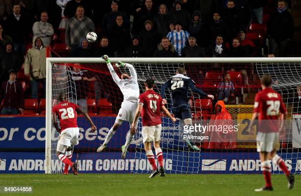 Charlton Athletic's goalkeeper Ben Hamer tips a header from Huddersfield Town's Simon Church over the bar during the npower Football League...