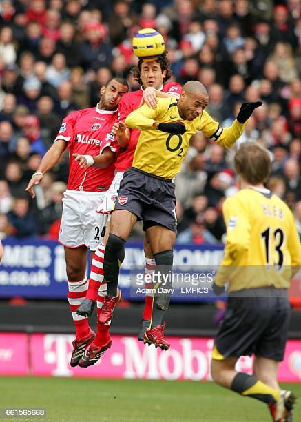 Charlton Athletic's Gonzalo Sorondo and Jonathan Fortune battle with Arsenal's Thierry Henry