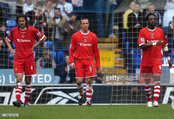Charlton Athletic's Gonzalo Sorondo Chris Perry and Jason Euell stand dejected