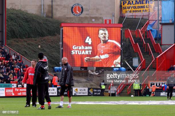 Charlton Athletic's Graham Stuart warms up in front of a picture of himself on the new Jumbotron screen at the Valley
