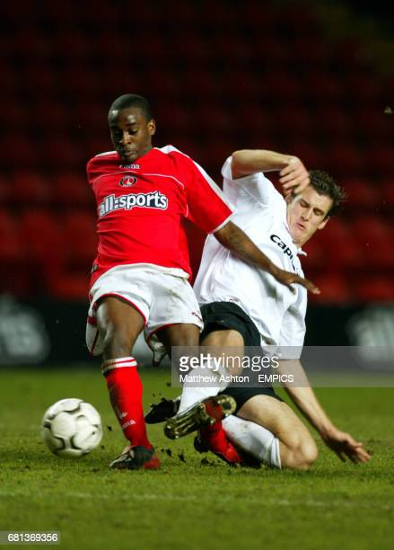 Charlton Athletic's Jamal CampbellRyce gets tackled by David Tarka of Nottingham Forest before going off injured on a stretcher