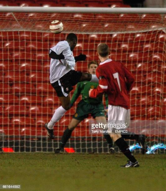 Charlton Athletic's James Walker heads the opening goal past Manchester United goalkeeper RonRobert Zieler